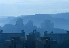 Misty morning high rise buildings royalty free stock photos
