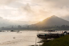 Misty morning on the khong river with Silhouette of boat in loei Royalty Free Stock Photos