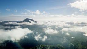 Misty morning on the Kintamani mountain. Beautiful scenery at misty morning on the Kintamani mountain in Bali, Indonesia Royalty Free Stock Image