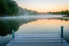 Misty Morning Lake. A mist cover lake in the early morning. Mount Saint Francis, Indiana stock image