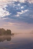 Misty morning on the lake. Stock Images