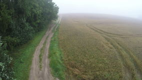 In misty morning landing drone on rural gravel road stock footage
