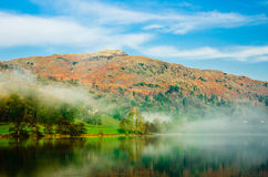 Misty morning. Mist lifting over Grasmere water Royalty Free Stock Images