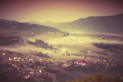 Misty morning in the mountain village. Royalty Free Stock Photo