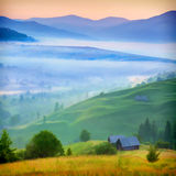 Misty morning in the mountains village. Royalty Free Stock Photo