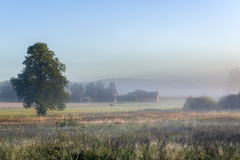Misty morning over small village in Poland Royalty Free Stock Images
