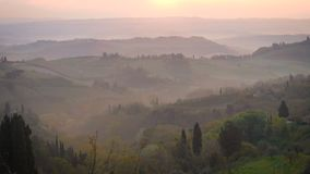 Morning panorama of Toscana. Misty morning panorama from the San Gimignano walls, Toscana, Italy stock footage