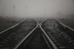 Dark misty railway tracks view stock photo