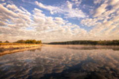 Misty morning on the river and clouds reflected in water Stock Images