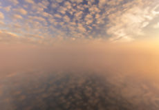 Misty morning on the river and clouds reflected in water Royalty Free Stock Photos