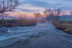 Misty morning on the river. In early spring stock photography