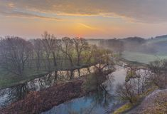 Misty morning on the river Stock Images