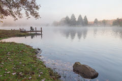 Misty morning on the Rock Lake, West Virginia. Foliage colors Royalty Free Stock Images
