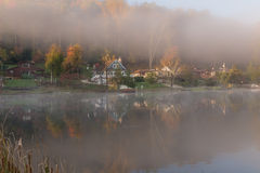 Misty morning on the Rock Lake, West Virginia. Foliage colors Royalty Free Stock Photography