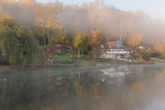 Misty morning on the Rock Lake, West Virginia. Foliage colors Royalty Free Stock Image