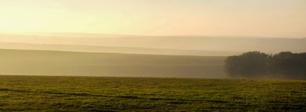 Misty morning rolling hills stock image