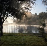 Misty Morning with sun. Breaking through royalty free stock image