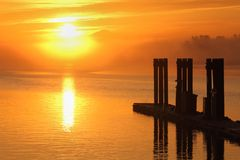Misty Morning Sun, Steveston Harbor. Sunrise in Steveston Harbor, British Columbia, Canada. Located at the mouth of the Fraser River near Vancouver Stock Photos