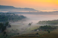 Misty morning sunrise in mountain at Khao-kho Phetchabun,Thailan Stock Photos