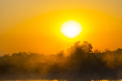 Misty morning sunrise over a dam Royalty Free Stock Image