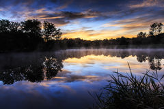 Misty Morning Sunrise Reflection In A Lake Royalty Free Stock Photos