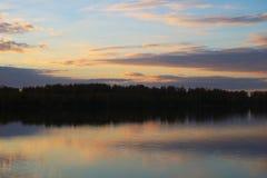Misty morning sunrise reflection in a lake stock image