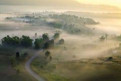 Misty morning sunrise and road in mountain at Khao-kho Phetchabu Royalty Free Stock Images