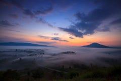 Misty morning sunrise and road in mountain at Khao-kho Phetchabu Royalty Free Stock Photos