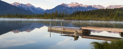 Misty Morning on Vermillion Lakes. A misty morning panorama of a dock on the Vermillion Lakes in Banff, AB in Banff National Park,  Canada Stock Photography
