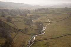 Misty morning view along Malham Beck and Dale in Yorkshire Dales Royalty Free Stock Images
