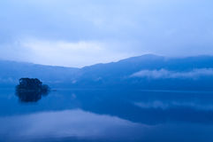 Misty morning. View of Tarbet island on Loch Lomond Royalty Free Stock Images