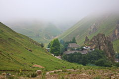 Misty morning in the village of mountain willage. Royalty Free Stock Image