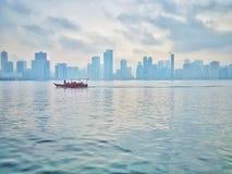 Misty mornings. Shot on: Samsung galaxy s7edge. Location: Sharjah, UAE. Misty mornings samsung uae abudhabi sharjah dubai travel building buildings boat blue stock image