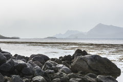 Misty mountain coastline in Norway Stock Images
