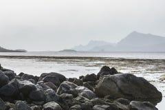 Misty mountain coastline in Norway Stock Images