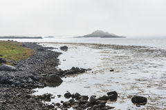 Misty mountain coastline in Norway Royalty Free Stock Photos