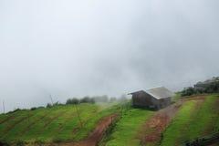 Misty mountain hut. Rains Stock Photography