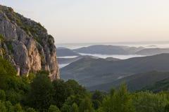 Misty mountain rock Stock Photos