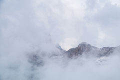 Misty mountain scene in Dolomites mountain Stock Photos