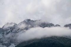 Misty mountain scene in Dolomites mountain Italy Stock Image