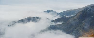 Misty mountain slops. Heavy cloud formation is covering the mountain Stock Images