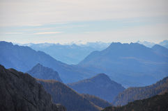 Misty mountain view over alps in austria Stock Photo