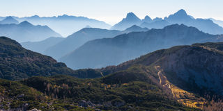 Misty mountains. Birds eye view on a forest and misty mountain range Royalty Free Stock Image
