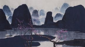 Misty mountains and flowering plum