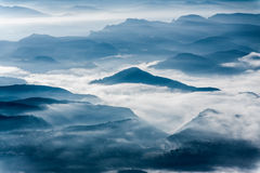 Misty mountains landscape Stock Images