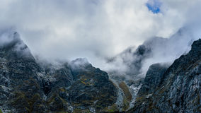 Misty mountains panorama Stock Photography