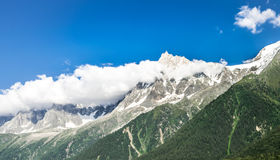 Misty mountains peak in Chamonix by Mont Blanc. Royalty Free Stock Image