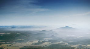 The misty mountains. The pointy mountain shrouded in the morning mist royalty free stock image
