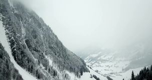 Misty mountains in winter aerial footage stock video footage
