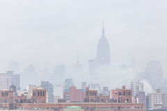 Misty New York City Manhattan skyline with Empire State Building. royalty free stock photography